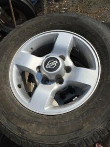 4 pneus General montés sur mags originaux NISSAN 225/65/R16