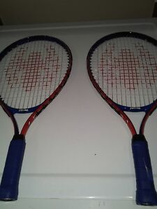 Pair of Spiderman tennis rackets for kids up to 4' tall