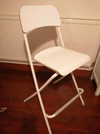 White IKEA folding chair