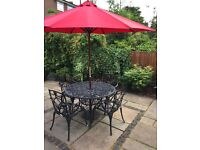 Black decorative metal table and chairs