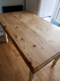 Stripped pine table with painted legs