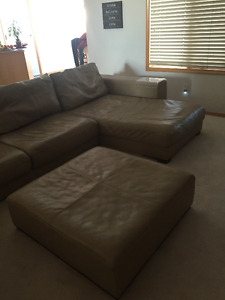 Natuzzi beautiful leather sectional with two Chaise and Ottoman
