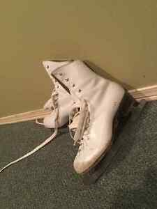 2 Pairs of girls figure skates for sale
