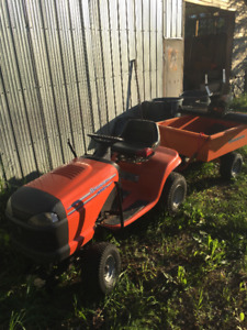 Husquvarna lawn tractor with trailer,plow weights and chains.