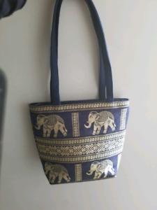 Elephant designed blue purse