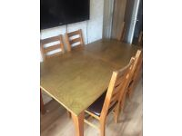 4-8 seater extending table and 4 chairs