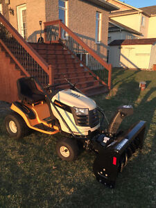 tractor whit lawn mower and snow blower