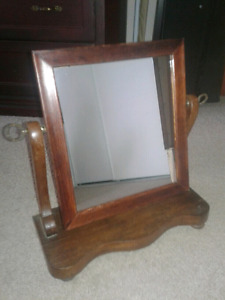 Antique shaving or make-up mirror.