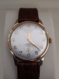 LONGINES Men's 9 ct. solid gold watch.