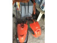 Two flymo lawnmowers for sale £40 Needing Repaired