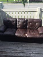 Free brown leather couch .. Perfect for basement or garage