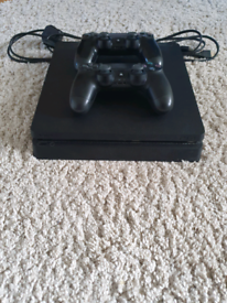 MINT HARDLY Used PS4 Slim 500gb + 2 controllers (One Brand New)