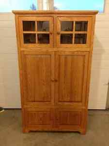 Oak entertainment cabinet with pocket doors