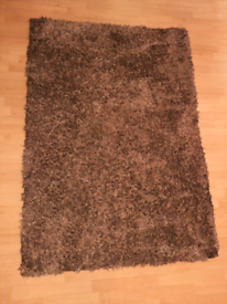 Dunelm Indulgence brown fluffy percian rug. Colour mink. Size: 120cm b