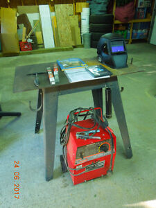 Welder with rods, table and helmet
