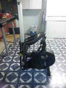 Recumbent exercise bike with rower