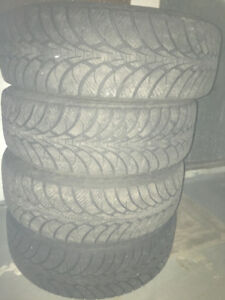 4 Goodyear tires with rims - very good condition