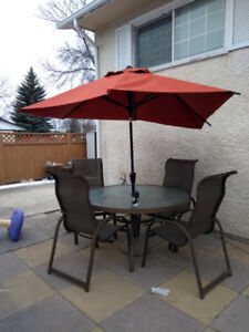 Patio table umbrella four high back chairs and solid bottom base
