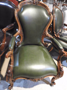 antique Victorian arm chairs,new green leather, detailed carving