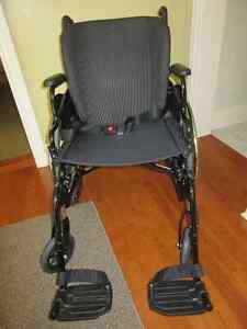 Manual Wheelchair with extra seat pads/cushions