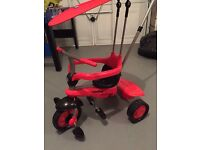 Red smart trike - excellent condition.