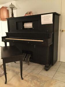 Piano mécanique en très bonne condition