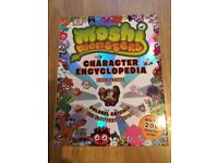 Moshi monsters book, with character, like new. £3.
