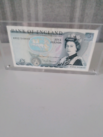 Old £5 note in case