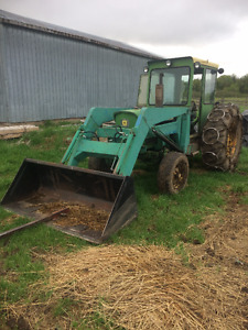 1120 john deere tractor, 2wd, cab/loader/snowblower/chains