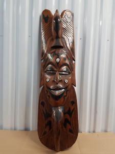 African carved wooden decorative mask