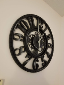 Large black wall clock