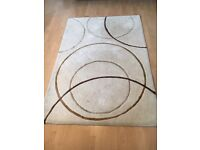 Cream/beige rug with circle pattern