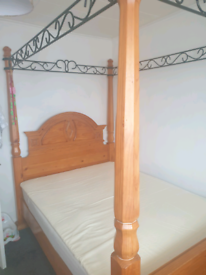 Solid four poster bed. Heavy