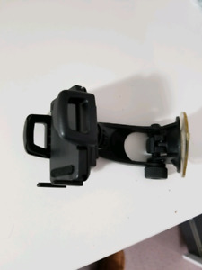 Windshield mount universal cell phone holder.