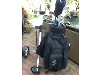 Full. Set of HOWSON BLAZER GOLF ClUBS BAG AND TROLLY