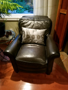 2 black almost navy leather chairs