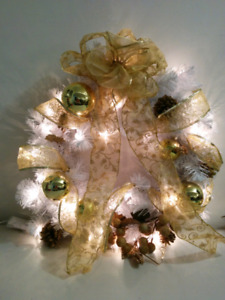 White wreath with gold ribbon and decorations