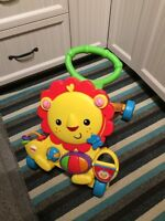 Lion trotteur musical fisher price