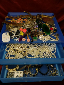 Blue container full of costume jewelry