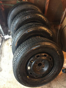 Barely used 15 inch Firestone All Season Tires
