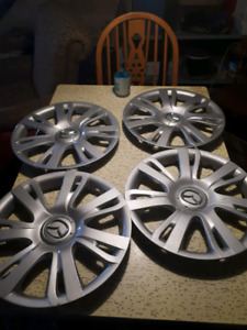 Full set of 4 hubcaps for Mazda.