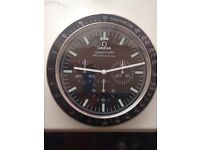 omega speedmater wall clock ..dealer display item..