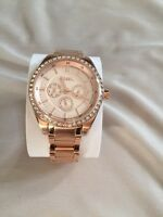 Brand new rose gold fossil watch.