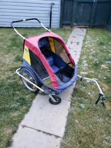 Bike trailer/Enclosed stroller.