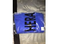 Unworn Hera jumper size M in blue with yellow writing
