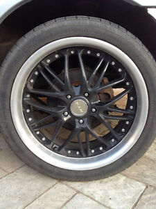 "18"" black RTX rims with low profile tires"