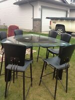Modern glass table with 6 leather chairs
