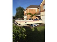 17 feet open dory 115hp Suzuki Fourstroke twin axle roller coaster trailer