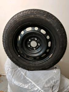 Winter tires - Michelin X-Ice on rims - 205/65R16