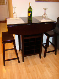 Beautiful Pub Style table set with saddle stools like new must c